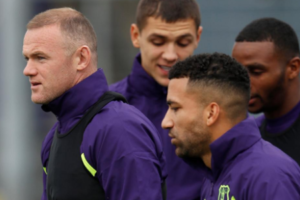 Wayne Rooney Draws Contrast
